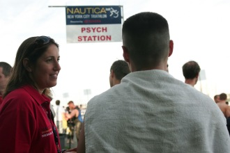 Photographer > ULI SEIT/ July 22 2007   TRIATHLON/ 99th & Riverside Park, swim  Psychologists standing by at the NYC triathlon to assist competitors . Psychologists Stacey Rosenfeld Ph.D  speaking to competitor before the race
